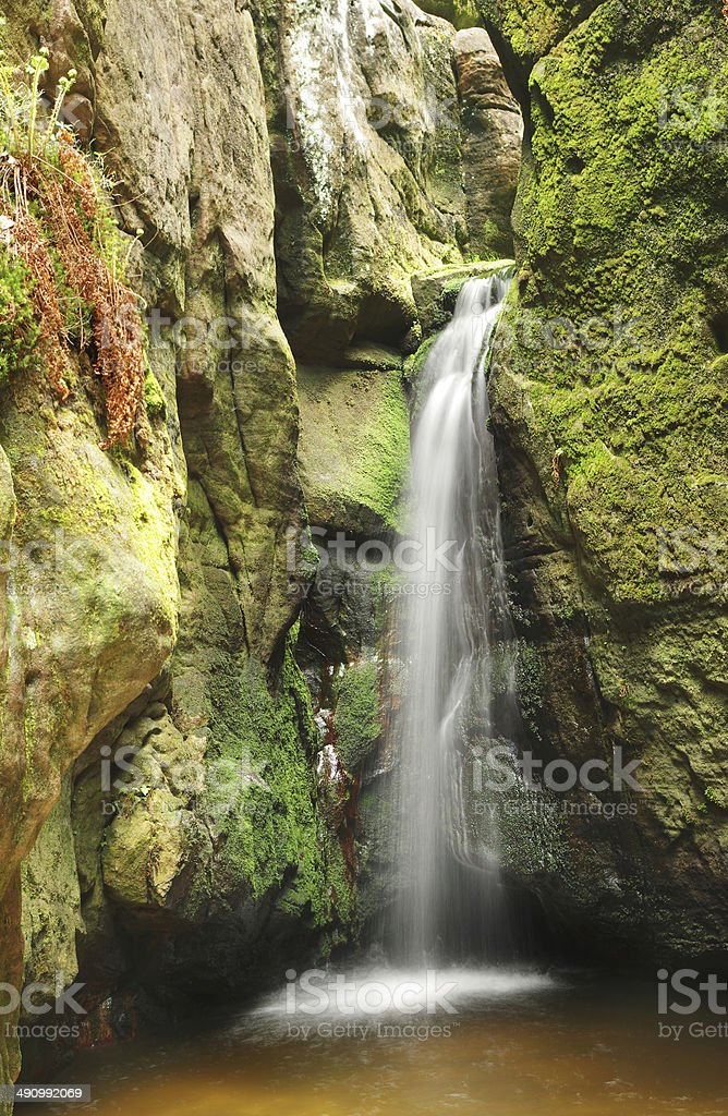 little waterfall in Skalne Mesto Adrspach Czech Republic stock photo