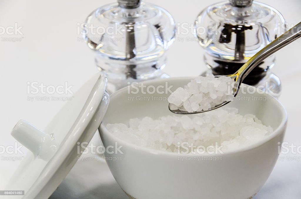 Little white ceramic bottle with sugar stock photo