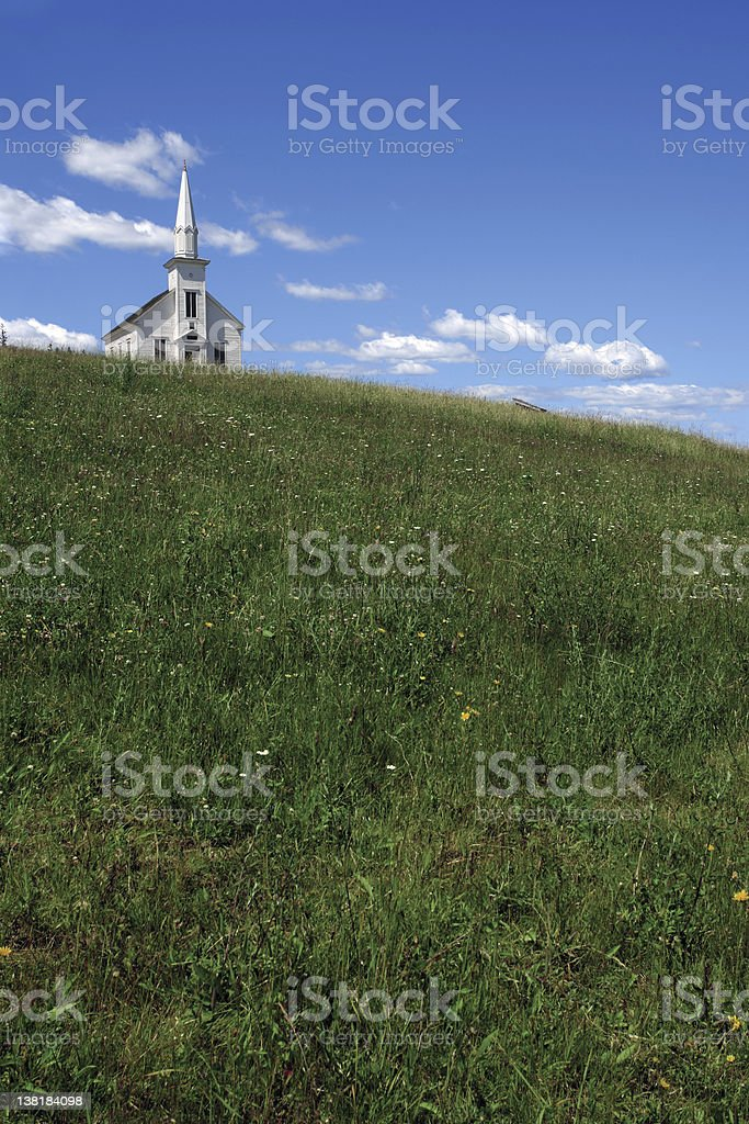 Little white church over the hill stock photo