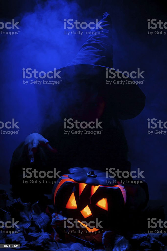Little witch with halloween pumpkin stock photo