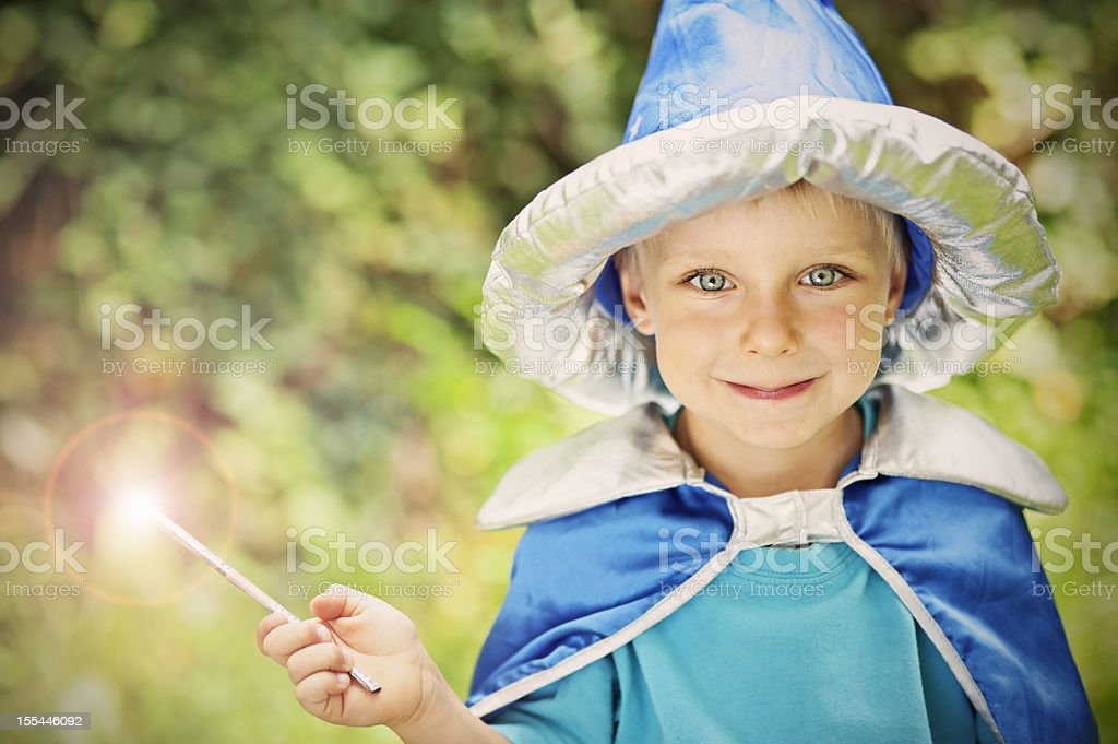 Little wizard in forest stock photo