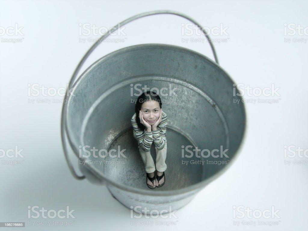 Little Woman Sitting on Bottom of Tin Bucket royalty-free stock photo