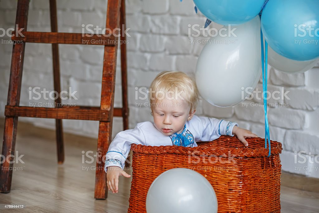 Little-year-old blond boy in traditional Ukrainian embroidered s stock photo