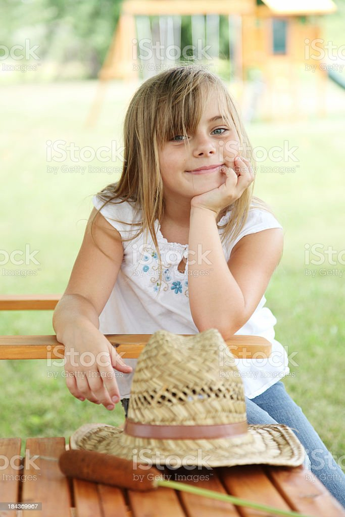 Littlle country girl in backyard. royalty-free stock photo