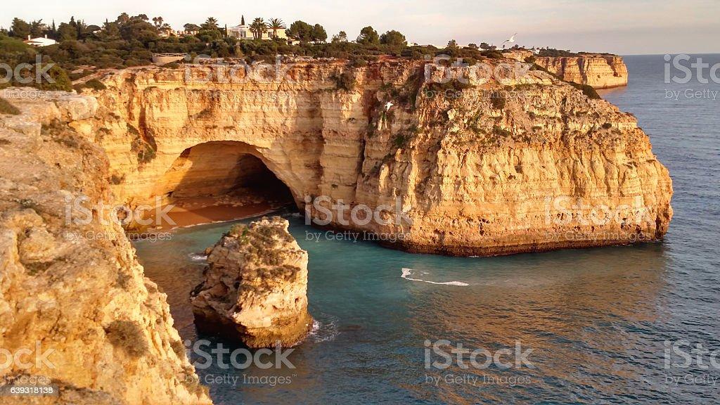 Littoral sea cave and rocky Algarve Coast near Carvoeiro Portugal stock photo