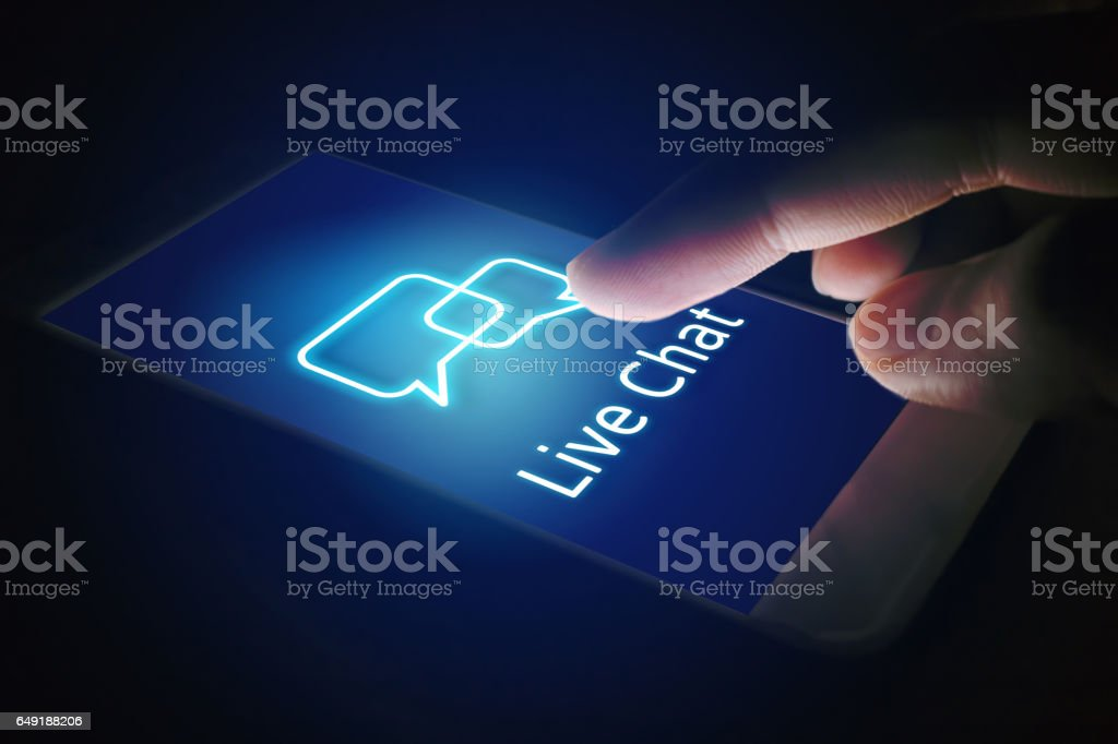Live chat technology concept, woman hand pressing virtual screen. stock photo