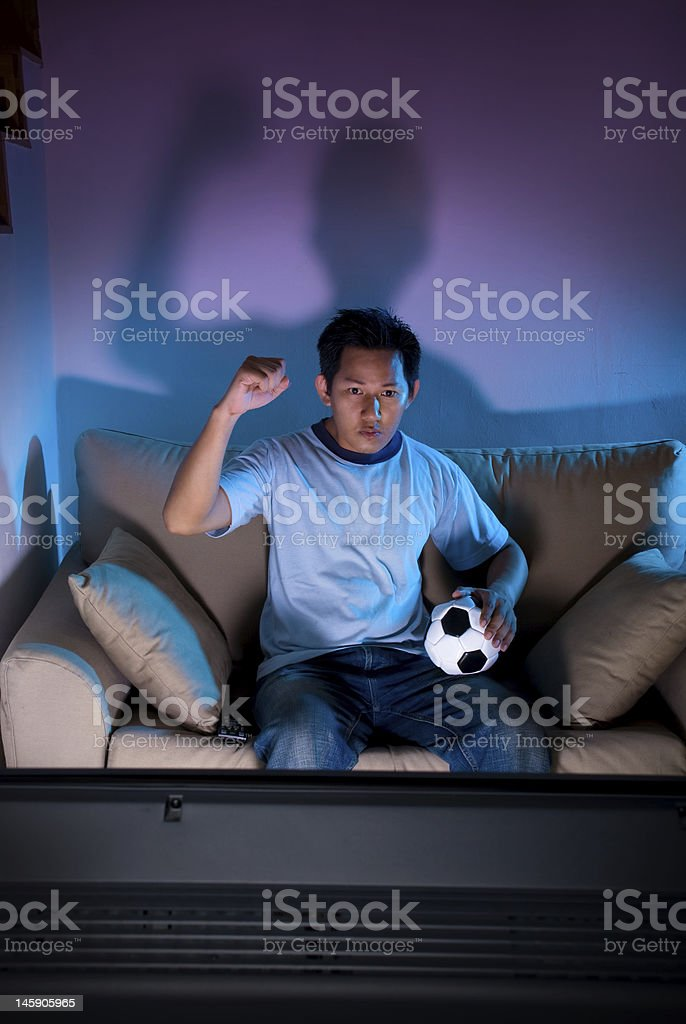 Live football game on TV royalty-free stock photo