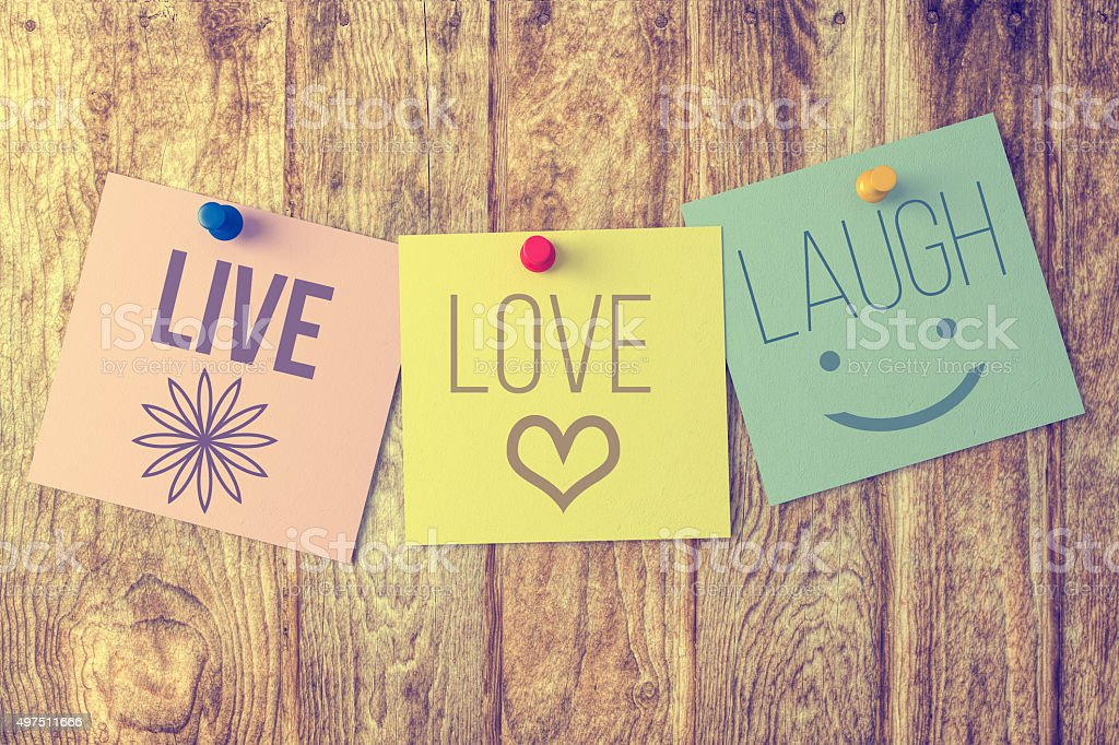 Live laugh love on wooden background stock photo