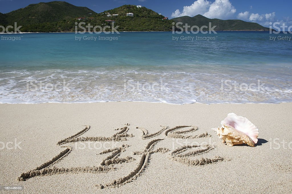 Live Life Inspirational Message in Sand with Shell Tropical Beach stock photo