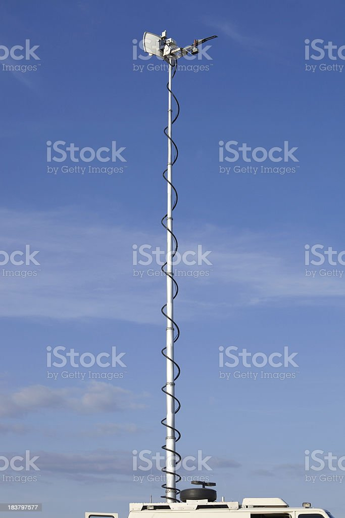 Live News Truck Microwave Antenna against Blue Sky stock photo