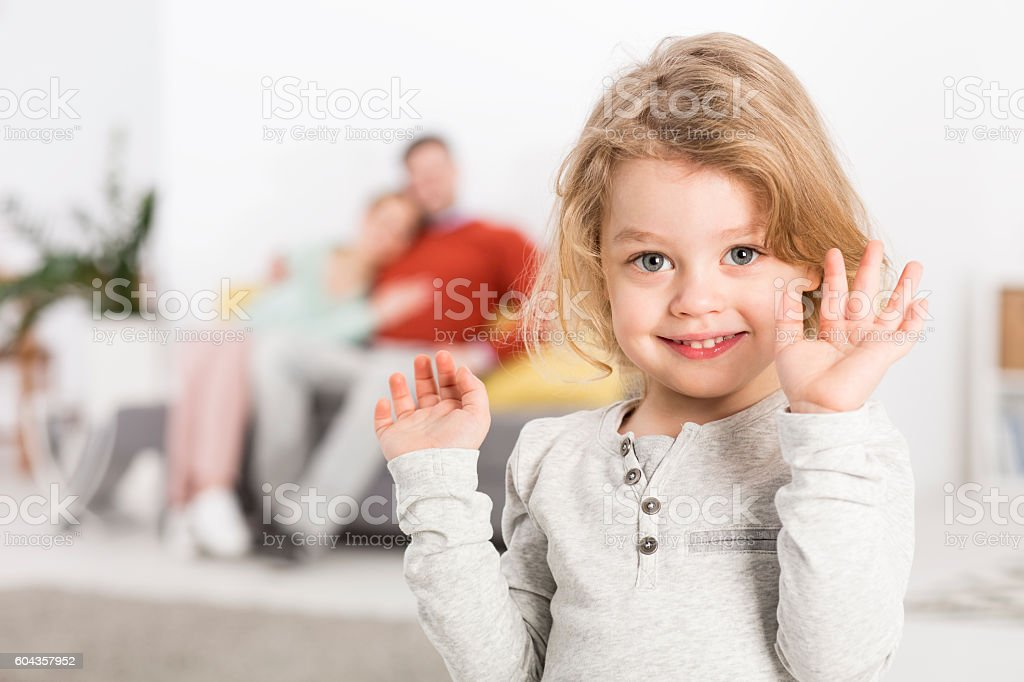 Lively joy of a child in the family stock photo