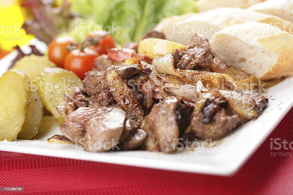 liver meat with onion and vegetables royalty-free stock photo