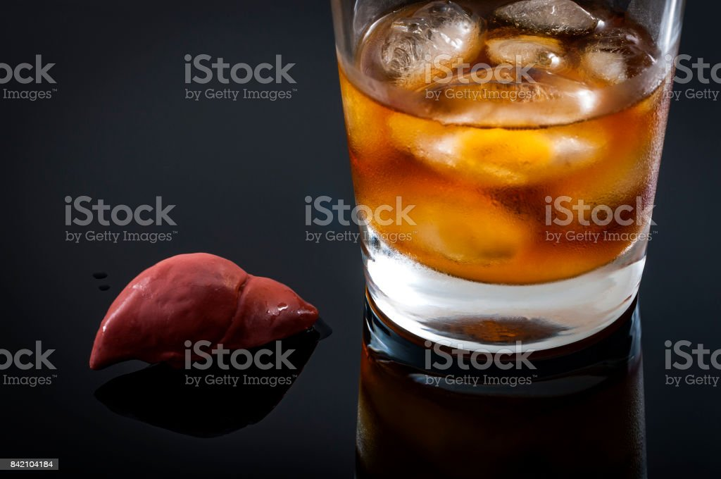 Liver next to a glass of whiskey stock photo