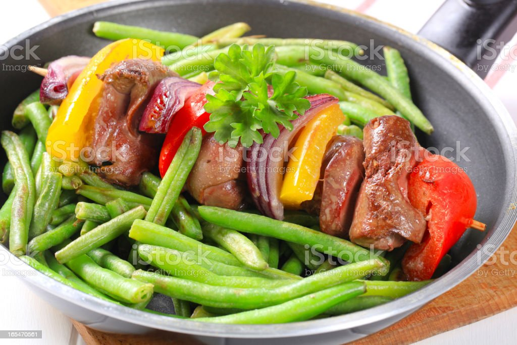 Liver skewer with green beans royalty-free stock photo