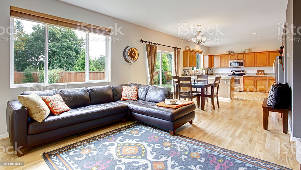 Living room and kitchen with dining area stock photo