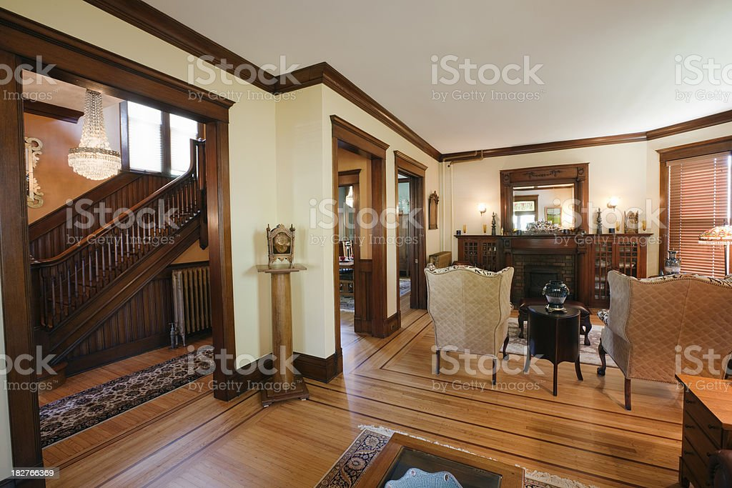 Living Room and Staircase of Restored Renovated Victorian Home Interior royalty-free stock photo