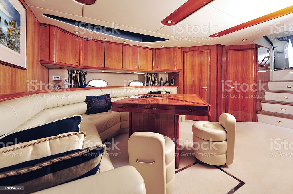Living room area of a yacht, with a couch, table. and chairs royalty-free stock photo