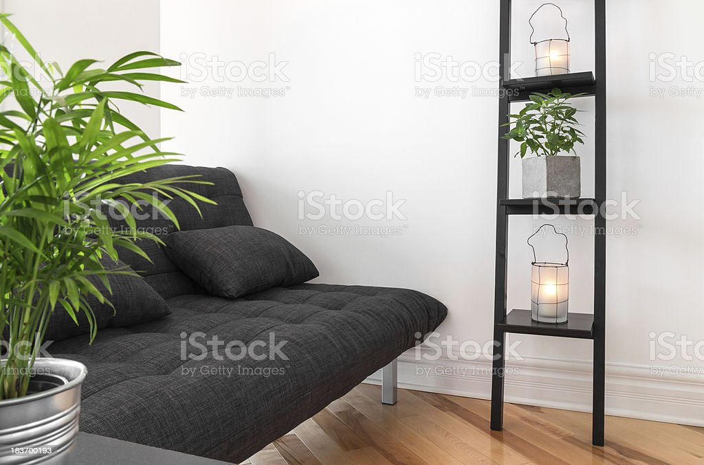Living room decorated with plants and lanterns stock photo