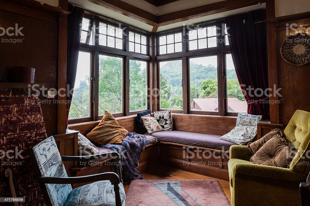 Living room in 1920s bungalow with vintage furniture royalty-free stock photo