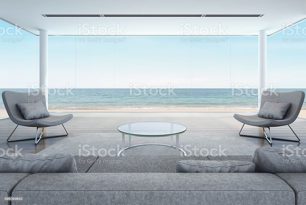 living room in beach house, modern interior with sea view stock photo