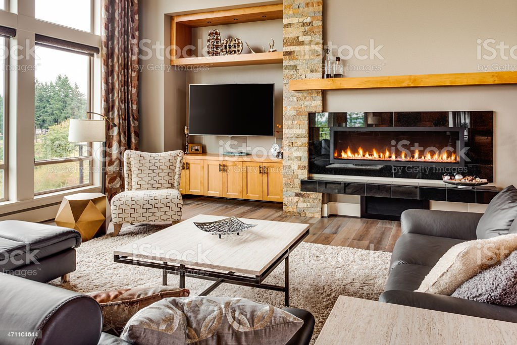 Living Room in Luxury Home with Fireplace and TV stock photo