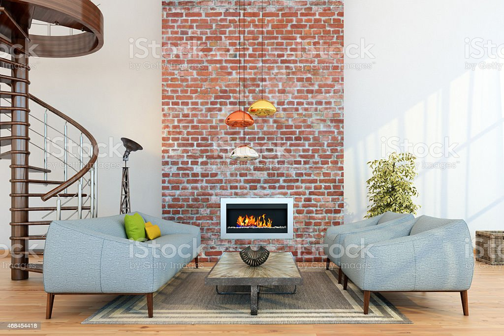 Living room setup around a fireplace on a brick wall stock photo