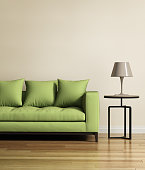 Living room with a light green sofa