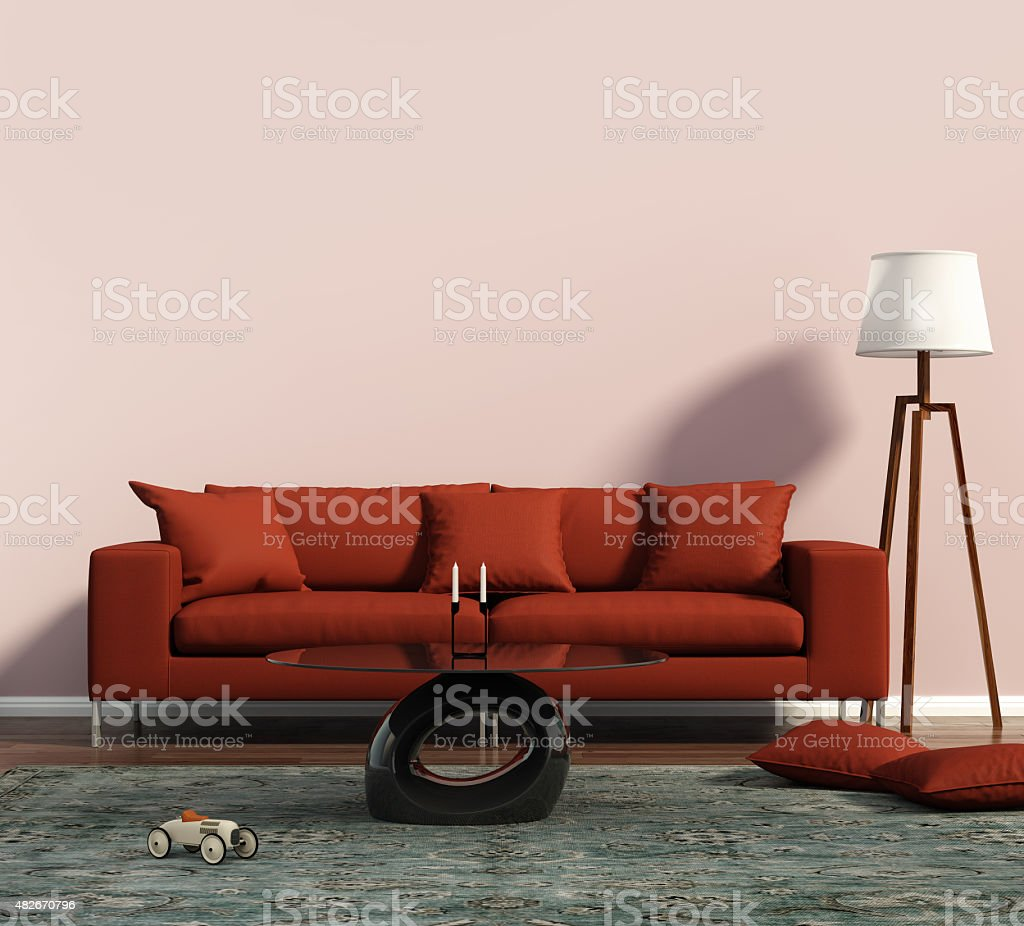 Living room with a red sofa and a geometrical rug stock photo