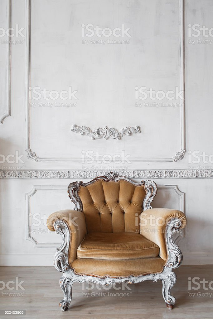 Living room with antique stylish beige armchair on luxury white stock photo