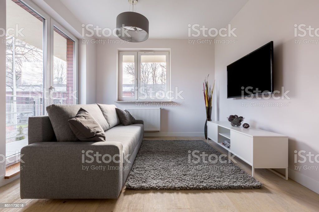 Living room with brown couch stock photo