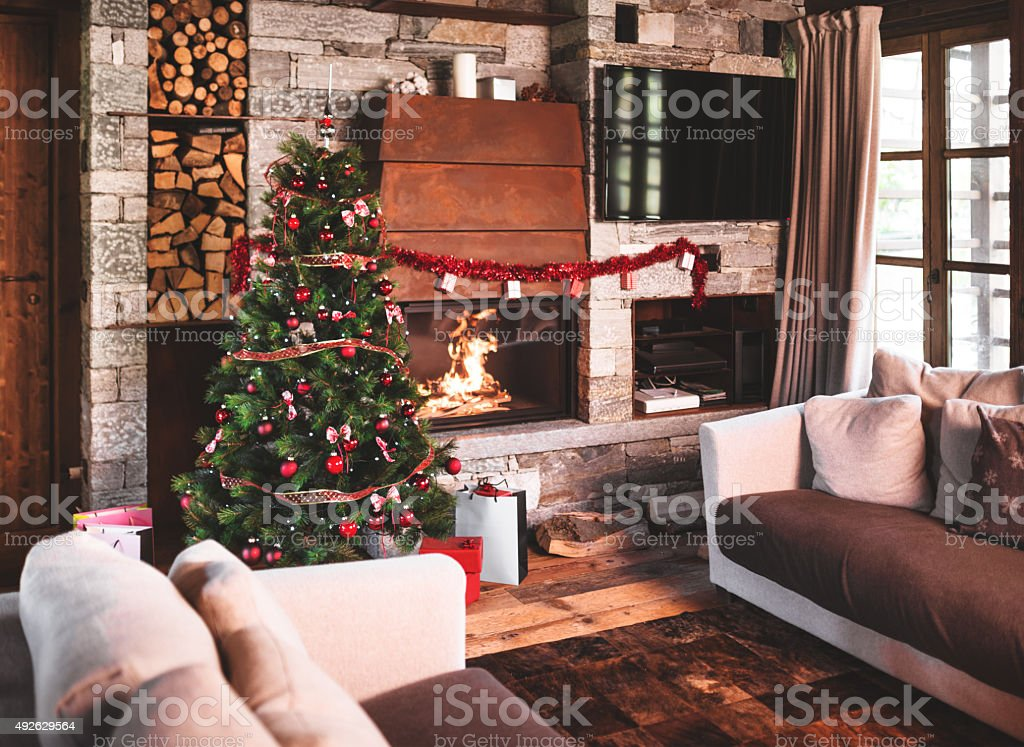 living room with christmas tree and the fireplace stock photo