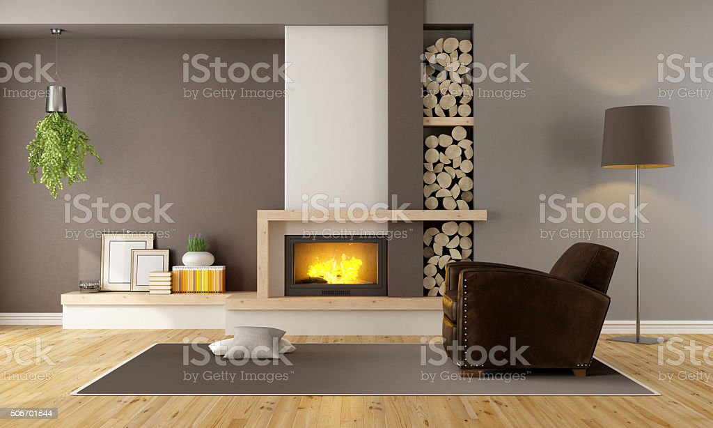 living room with fireplace and vintage armchair stock photo
