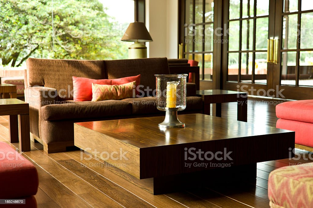 Living room with large window and square wooden coffee table royalty-free stock photo