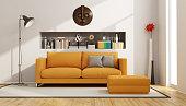 Living room with orange sofa