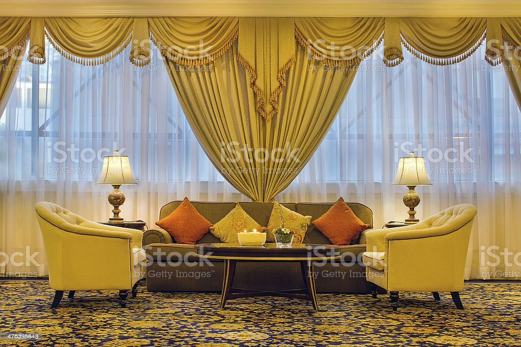 Living Room with Ornate Curtains and Furniture stock photo