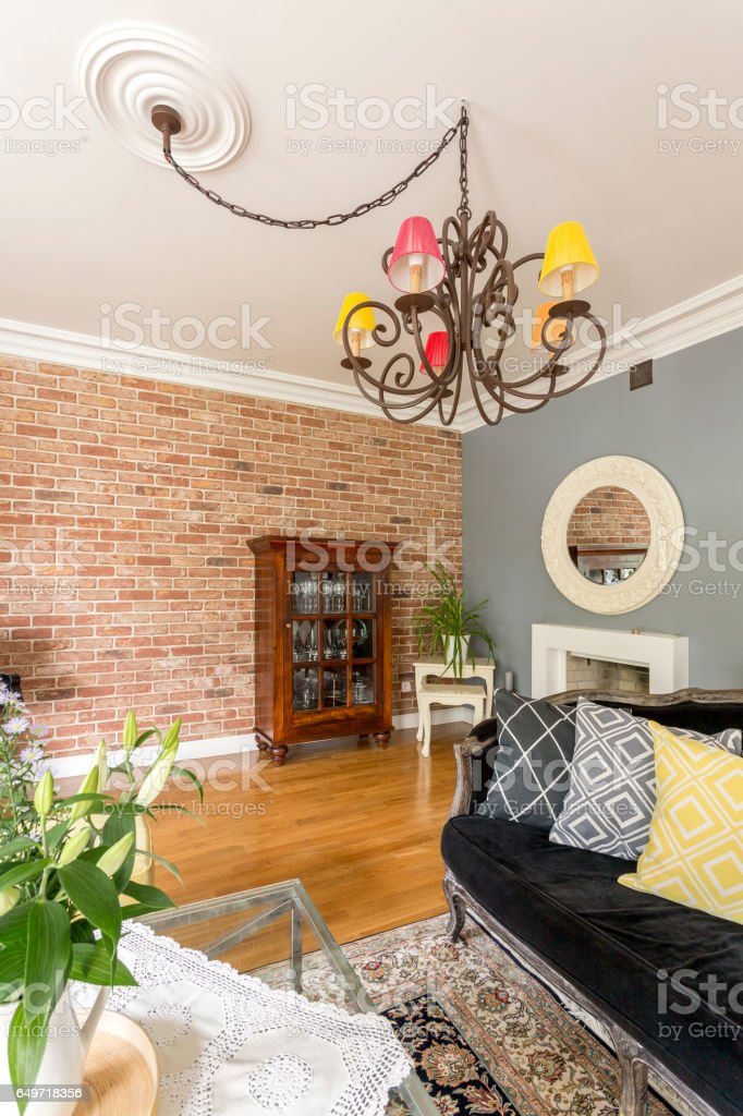 Living room with sofa and antique chandelier stock photo