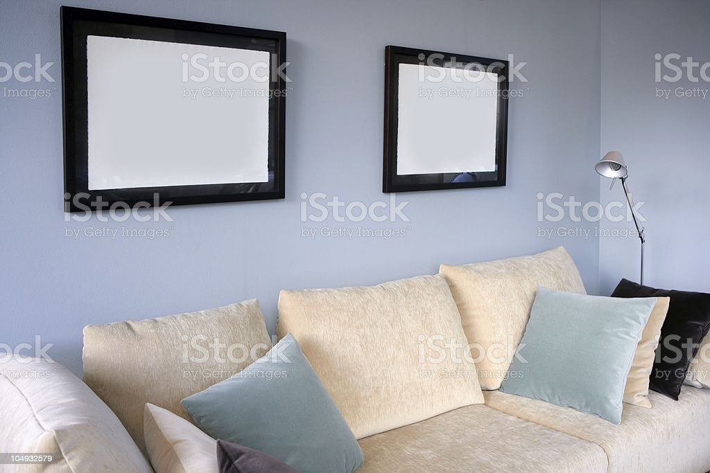 Living room with sofa and blue wall, interior design royalty-free stock photo
