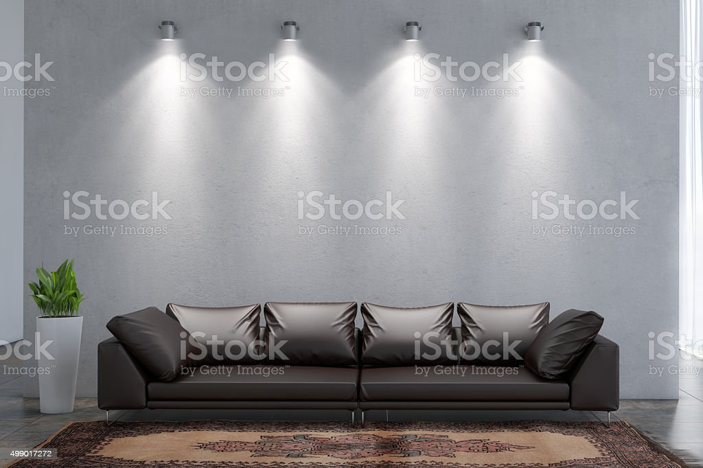 Living room with sofa in front of a wall stock photo
