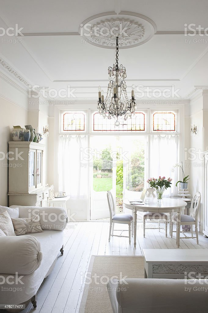 Living Room With Sofa; Table; Chairs And Chandelier stock photo