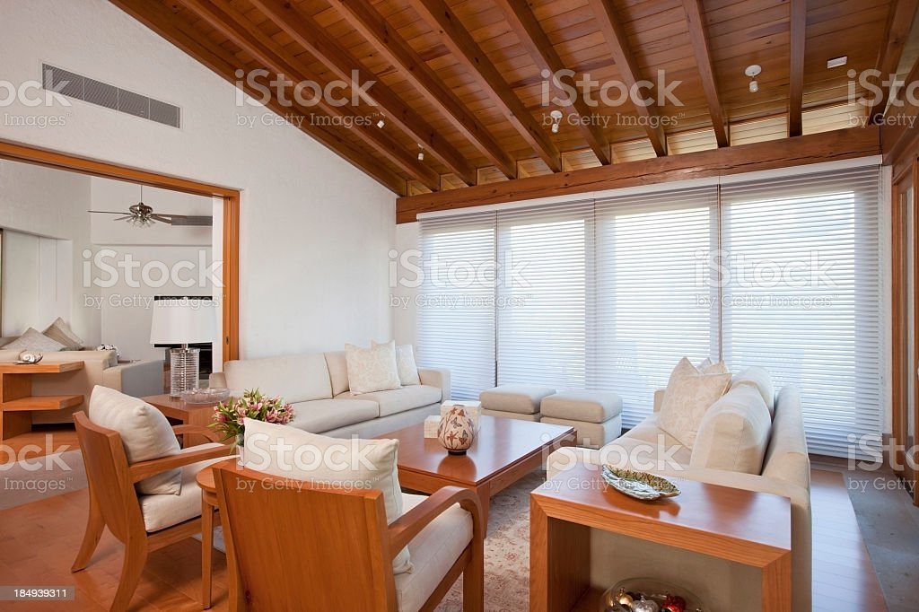 Living room with vaulted ceiling's in wood and white decor stock photo