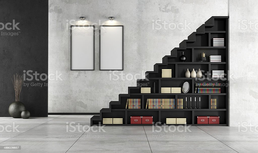 Living room with wooden staircase and bookcase stock photo
