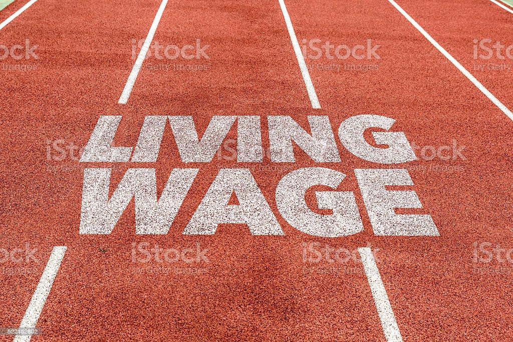 Living Wage written on running track stock photo