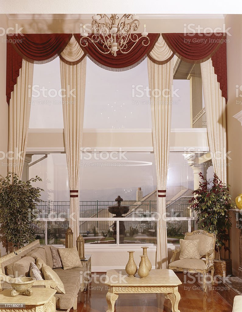 Livingroom with Elegant Window Drapes royalty-free stock photo