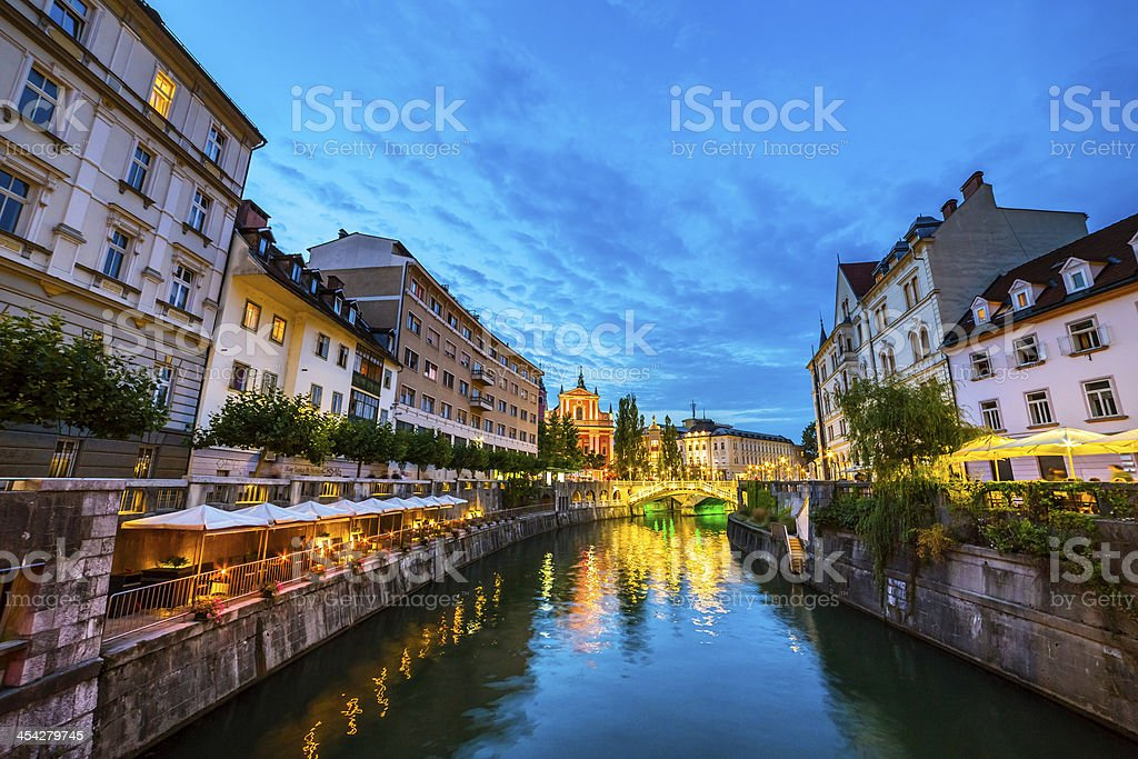 Ljubljana and Ljubljanica river at dusk stock photo