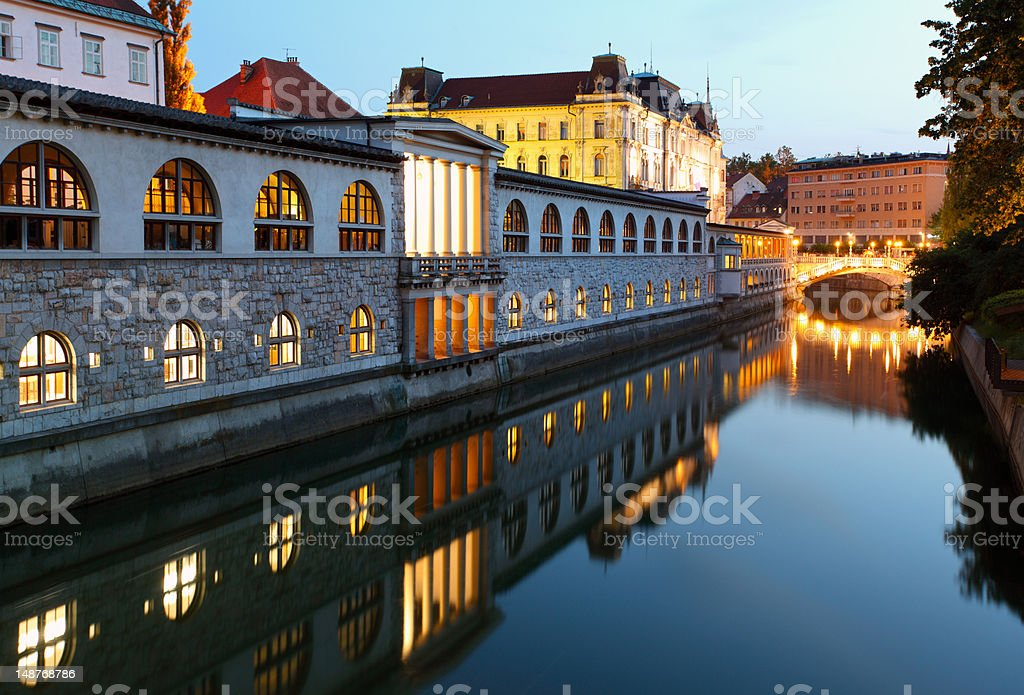 Ljubljana, Slovenia - Ljubljanica River and Central Market at night stock photo