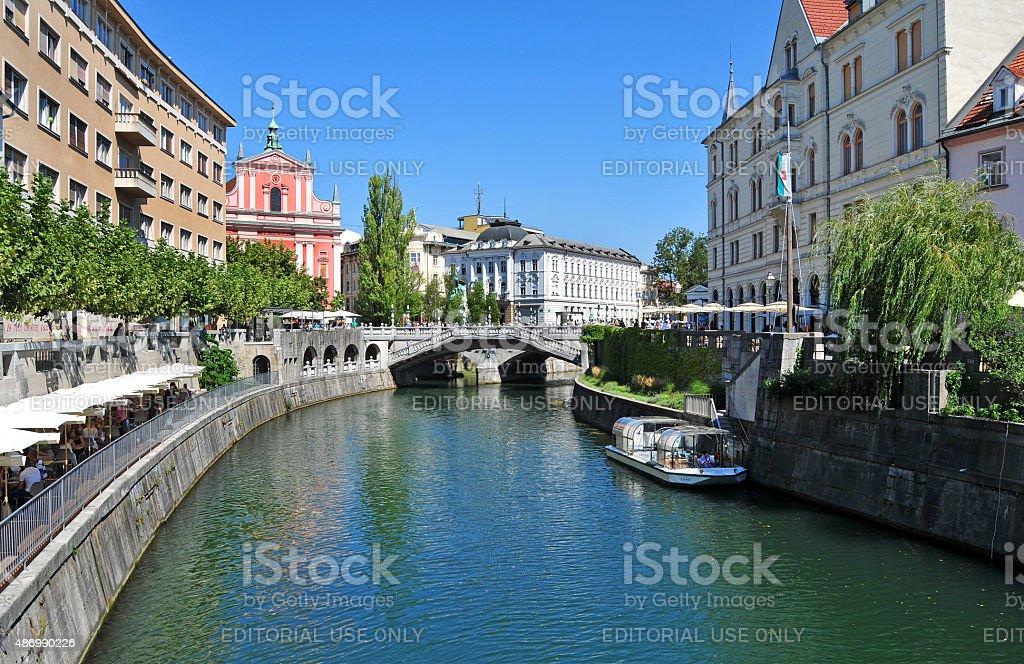 Ljubljanica river and three bridges in background, Ljubljana, Slovenia stock photo