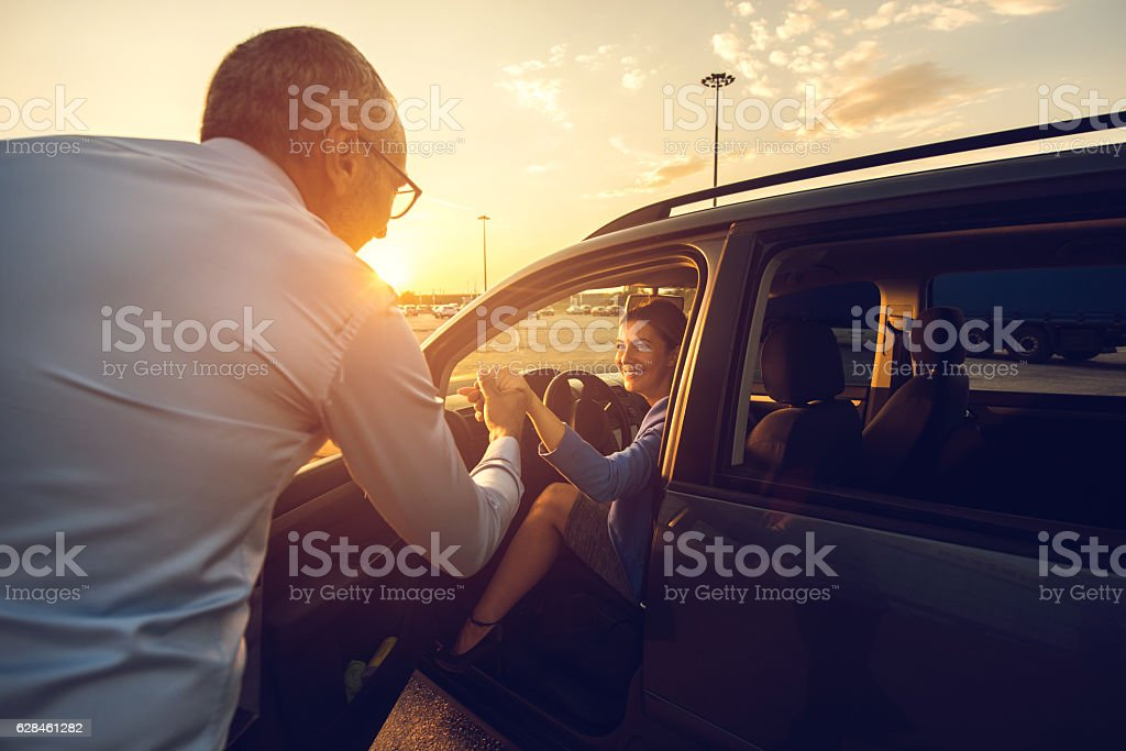I'll help you to get out of the car! stock photo