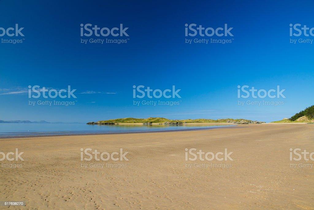 Llanddwyn Island, seen from beach, Anglesey stock photo