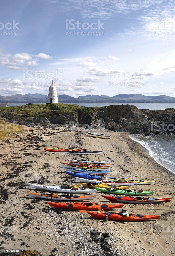 Llanddwyn Island with Sea Kayaks and Snowdonia royalty-free stock photo