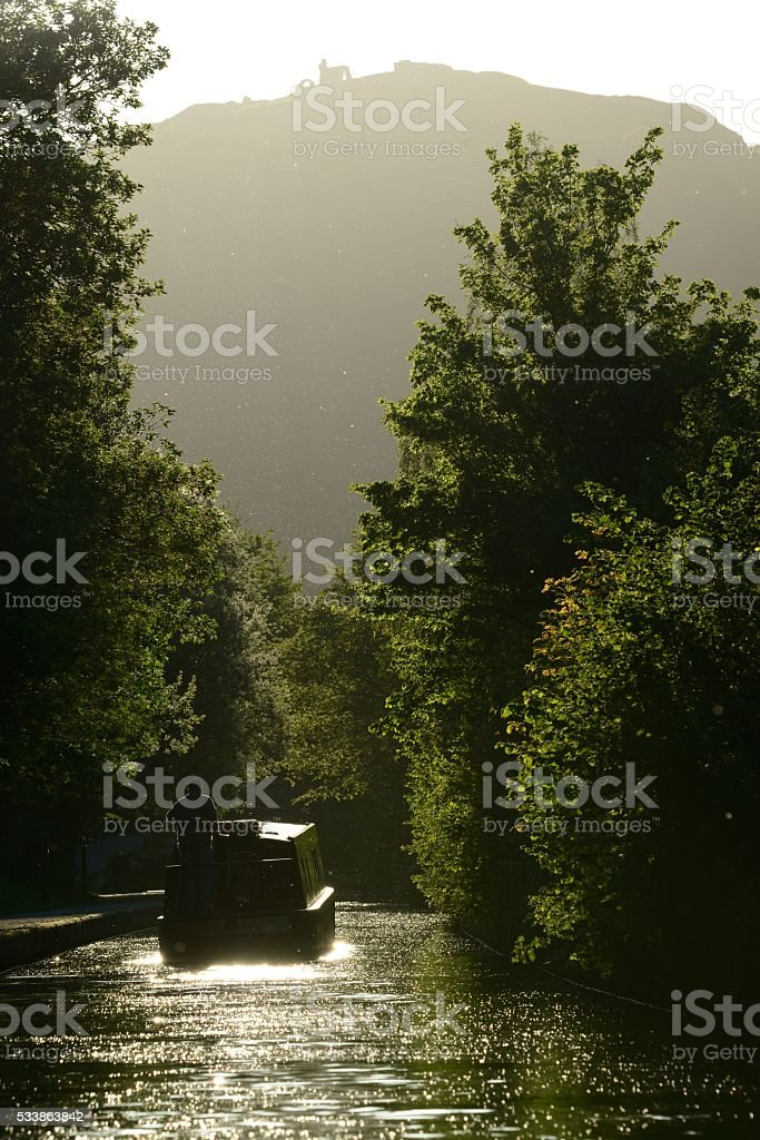 Llangollen Canal with narrow boat and Castell Dinas Bran portrait stock photo